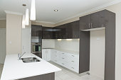 New modern kitchen with island bench and hanging lights