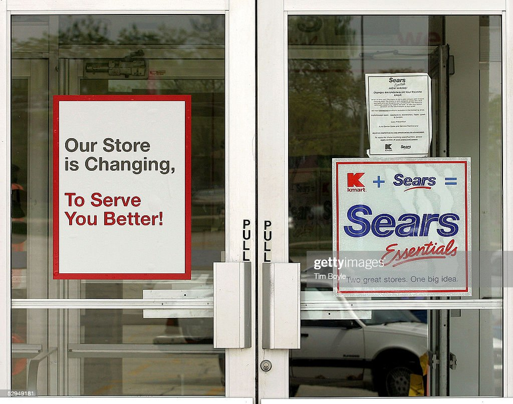 New 'Kmart plus Sears equals Sears Essentials' signage is seen on a door at a current Kmart store May 18, 2005 in Palatine, Illinois. This particular Kmart is in transition to become one of Sears' new stores called 'Sears Essentials.' Kmart recently bought Sears, Roebuck and Co. for $12.3 billion.