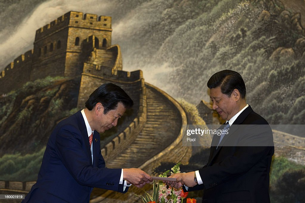 New Komeito party leader Natsuo Yamaguchi (L) of Japan delivers a personal letter from Japan Prime Minister Shinzo Abe to Chinese Communist Party Secretary-General <a gi-track='captionPersonalityLinkClicked' href=/galleries/search?phrase=Xi+Jinping&family=editorial&specificpeople=2598986 ng-click='$event.stopPropagation()'>Xi Jinping</a> during a meeting at the Great Hall of the People January 25, 2013 in Beijing, China, Yamaguchi said today that he believed Japan's dispute with China over a group of uninhabited islands could be resolved, according to published reports.