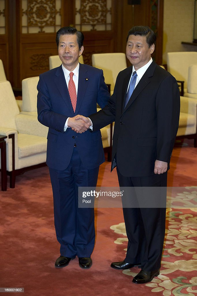 New Komeito party leader Natsuo Yamaguchi (L) of Japan shakes hands with Chinese Communist Party Secretary-General <a gi-track='captionPersonalityLinkClicked' href=/galleries/search?phrase=Xi+Jinping&family=editorial&specificpeople=2598986 ng-click='$event.stopPropagation()'>Xi Jinping</a> during a meeting at the Great Hall of the People January 25, 2013 in Beijing, China, Yamaguchi said today that he believed Japan's dispute with China over a group of uninhabited islands could be resolved, according to published reports.