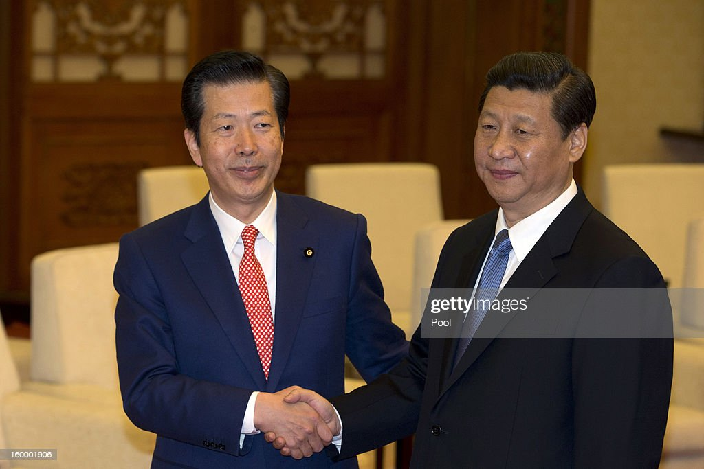 New Komeito party leader Natsuo Yamaguchi (L) of Japan shakes hands with Chinese Communist Party Secretary-General Xi Jinping during a meeting at the Great Hall of the People January 25, 2013 in Beijing, China, Yamaguchi said today that he believed Japan's dispute with China over a group of uninhabited islands could be resolved, according to published reports.
