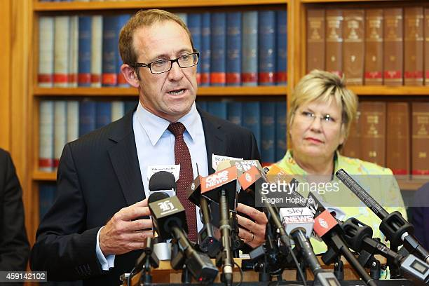 New Labour leader Andrew Little speaks to the media while Party President Moira Coatsworth looks on during a press conference at Parliament House on...
