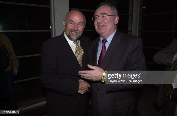 New Labour leader Pat Rabbitte is congratulated by departing leader Ruairi Quinn after he won the Labour leadership election in Dublin Republic of...
