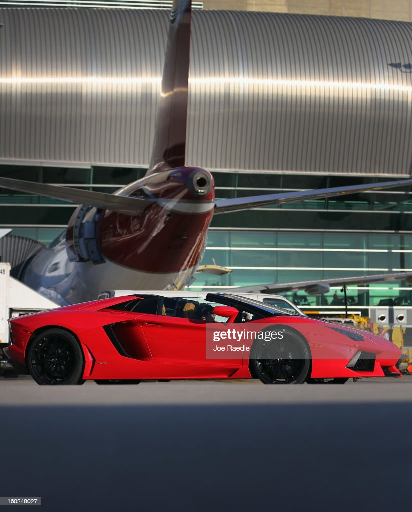 A new Lamborghini Aventador LP700-4 Roadster is seen on the tarmac at the Miami International Airporton January 28, 2013 in Miami, Florida. The unveiling of the new luxury super sports cars took place at the airport and included the vehicles driving down the south runway of Miami International Airport.