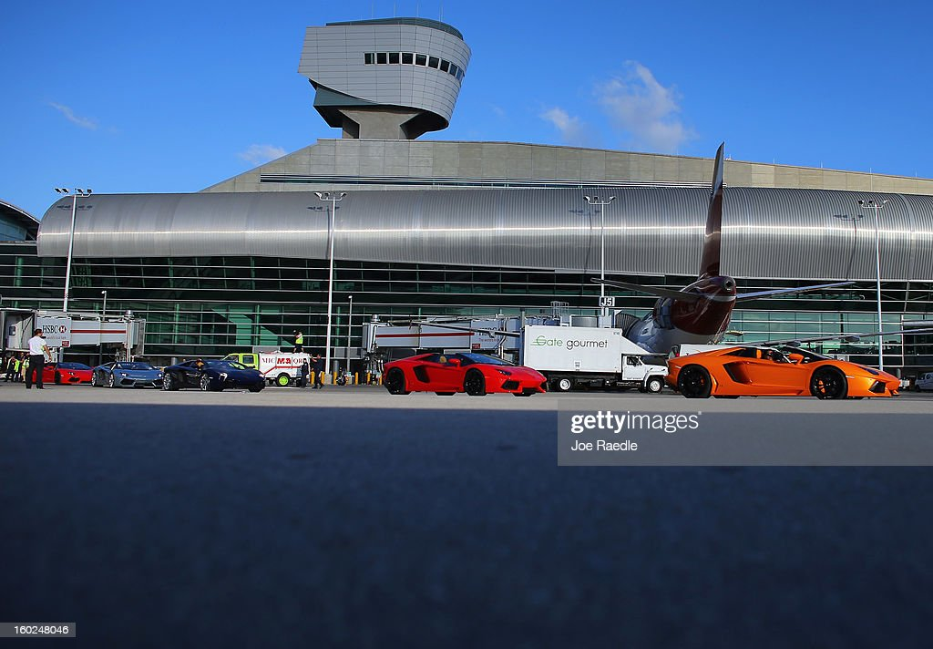 New Lamborghini Aventador LP700-4 Roadsters are seen on the tarmac at the Miami International Airporton January 28, 2013 in Miami, Florida. The unveiling of the new luxury super sports cars took place at the airport and included the vehicles being driven down the south runway of Miami International Airport.