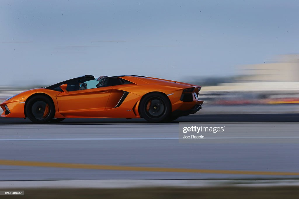 A new Lamborghini Aventador LP700-4 Roadsters is seen as it is driven along the south runway at the Miami International Airporton January 28, 2013 in Miami, Florida. The world wide unveiling of the new luxury super sports cars took place at the airport.
