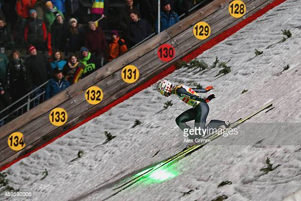 A new laser system shows the distance to beat as Kamil Stoch of Poland lands his qualification jump on day 1 of the Four Hills Tournament Ski Jumping...