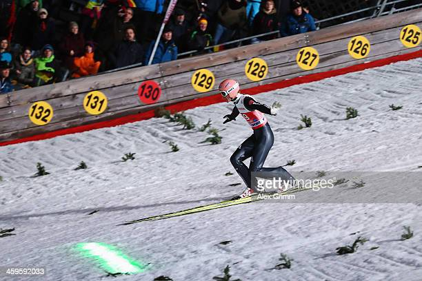 A new laser system shows the distance to beat as Severin Freund of Germany lands his qualification jump on day 1 of the Four Hills Tournament Ski...