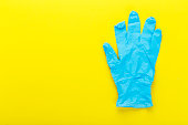 New latex gloves in blue on a contrasting yellow background
