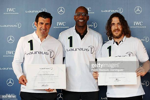 New Laureus Academy Member Luis Figo Laureus Academy Chairman Edwin Moses and New Laureus Academy Member Carles Puyol pose during the Laureus Academy...