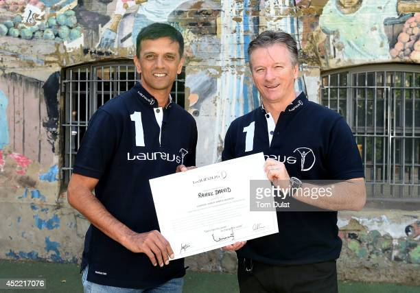 New Laureus Academy Member Rahul Dravid and Laureus Academy Member Steve Waugh pose for photographs during the Rahul Dravid Academy Announcement at...