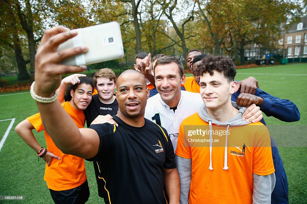 New Laureus Ambassador <a gi-track='captionPersonalityLinkClicked' href=/galleries/search?phrase=Andriy+Shevchenko&family=editorial&specificpeople=220501 ng-click='$event.stopPropagation()'>Andriy Shevchenko</a> takes a selfie with boys from the Street League National Social Enterprise at Corams Fields on November 2, 2015 in London, England.