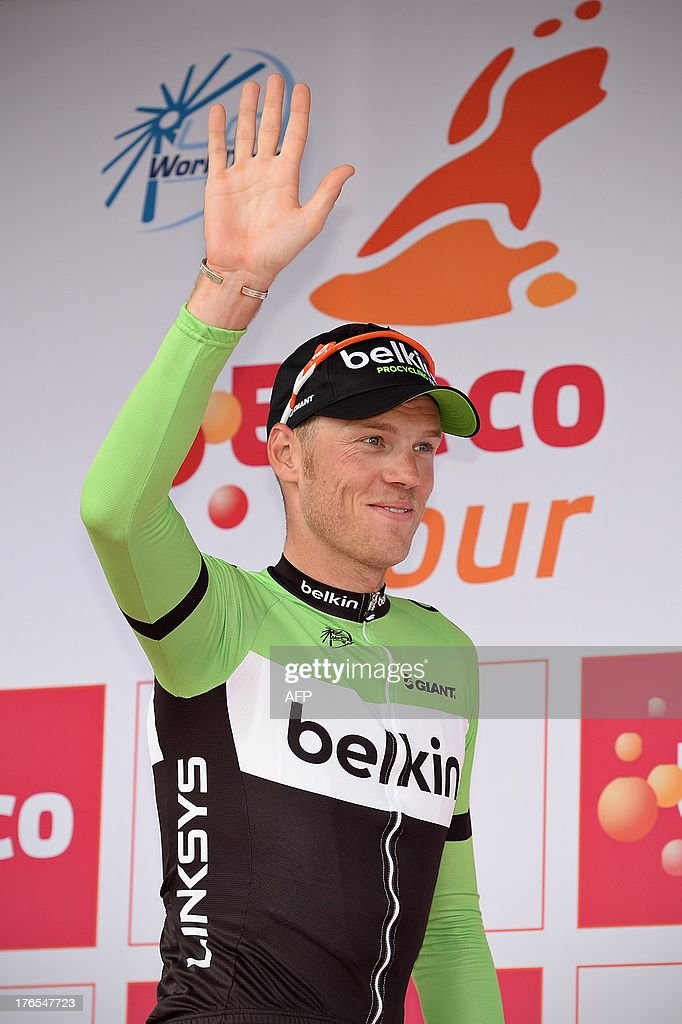 New leader in the general ranking Dutch Lars Boom of Belkin Pro Cycling Team celebrates on the podium after the fourth stage of the Eneco Tour cycling race, 176,3 km from Essen to Vlijmen, The Netherlands, on August 15, 2013.