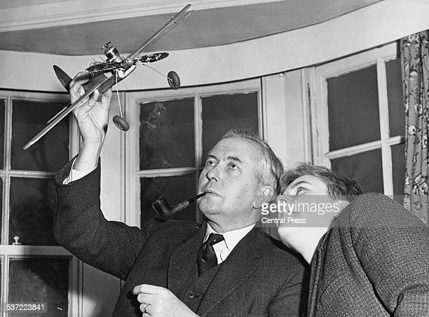 New Leader of the Opposition Harold Wilson and his son Giles looking at a model aircraft at their home Hampstead London February 11th 1963