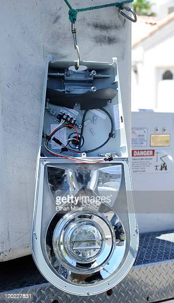 A new LED light fixture is secured to the side of a lift as crews replace existing street lights August 1 2011 in Las Vegas Nevada The new...