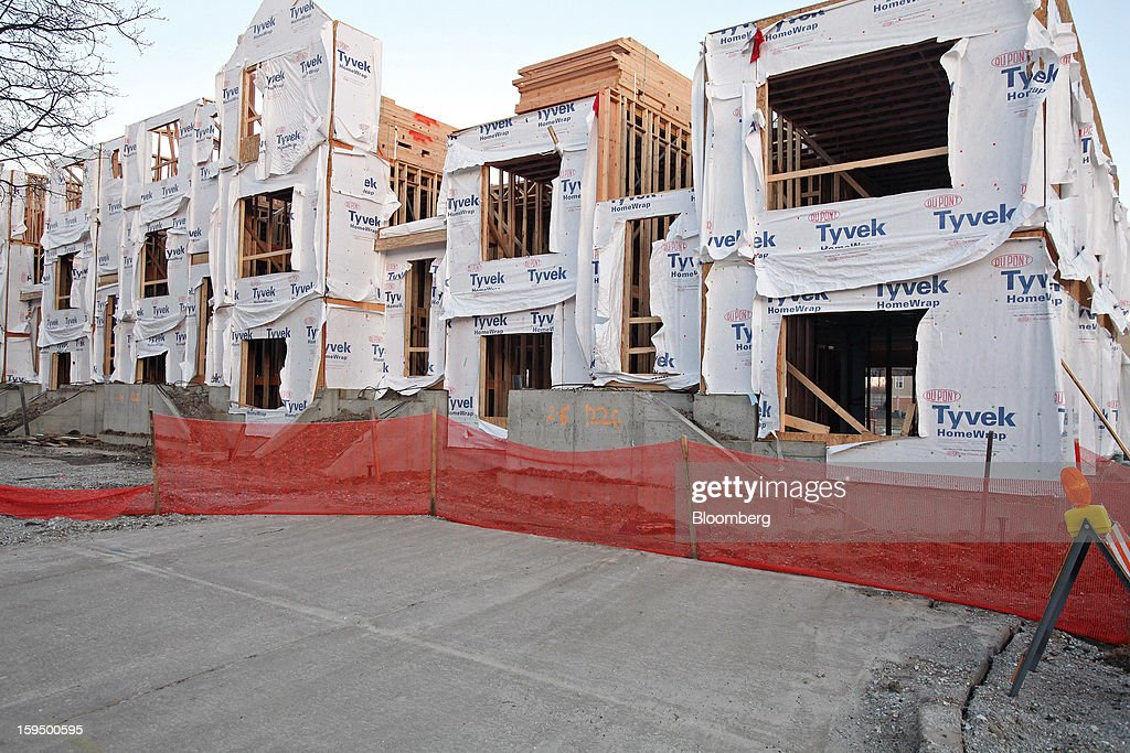 New Lexington Homes LLC townhomes stand under construction in Des Plaines, Illinois, U.S., on Monday, Jan. 14, 2013. The U.S. Census Bureau is scheduled to release housing starts figures on Jan. 17. Photographer: Tim Boyle/Bloomberg via Getty Images