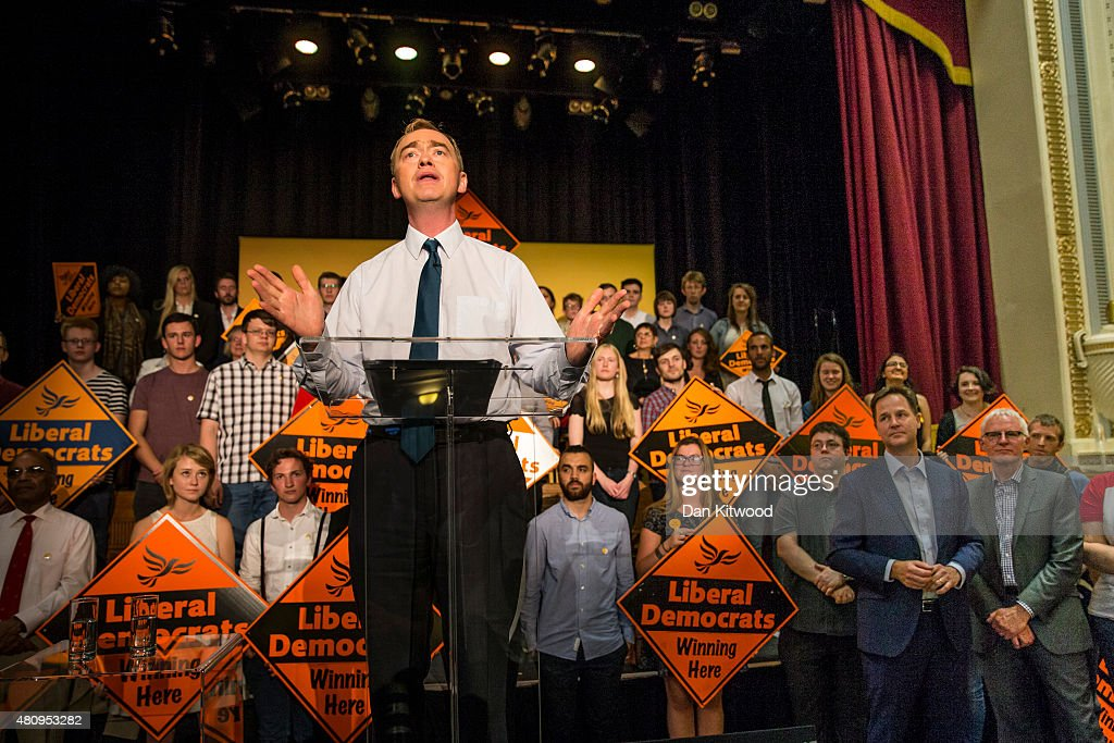 New Liberal Democrat Party Leader Tim Farron gives a speech as he becomes the new leader of the party, watched by former leader Nick Clegg (2nd R) and contender for the leadership, Norman Lamb (R) at Islington Assembly Hall on July 16, 2015 in London, England. Tim Farron, MP for Westmorland and Lonsdale, who was the former party president, will replace Nick Clegg after winning 56.5% of the votes.