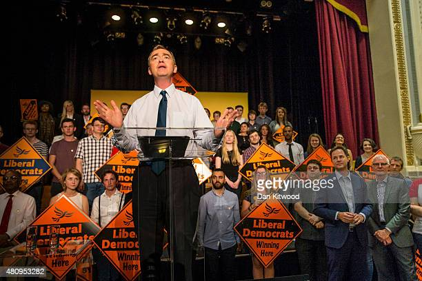 New Liberal Democrat Party Leader Tim Farron gives a speech as he becomes the new leader of the party watched by former leader Nick Clegg and...