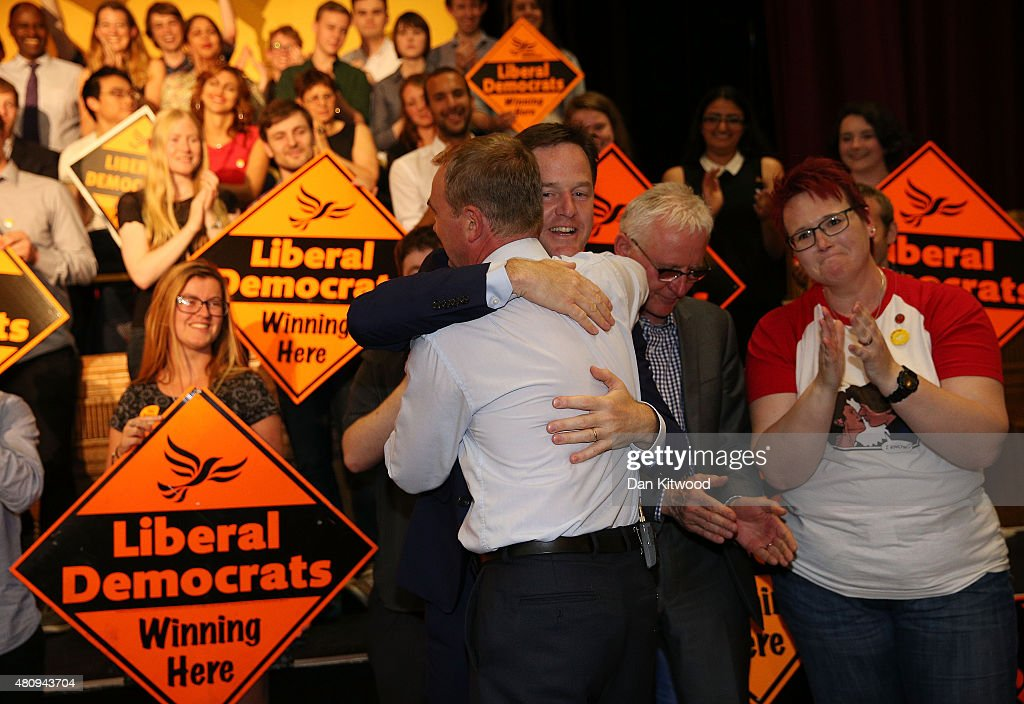New Liberal Democrat Party Leader Tim Farron hugs former leader of the party Nick Clegg applauds as contender for the leadership, Norman Lamb (2nd R) stands beside them at Islington Assembly Hall on July 16, 2015 in London, England. Tim Farron, MP for Westmorland and Lonsdale, who was the former party president, will replace Nick Clegg after winning 56.5% of the votes.