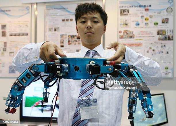 A new Limb Mechanism Robot named 'ASTERISK' of Arai Robotics Laboratory of Osaka University is displayed during the Japan Robot Week 2014 in Tokyo...