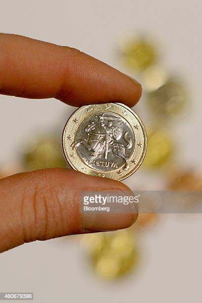 A new Lithuanian one euro coin is displayed in this arranged photo following manufacture at the Bank of Lithuania mint in Vilnius Lithuania on...
