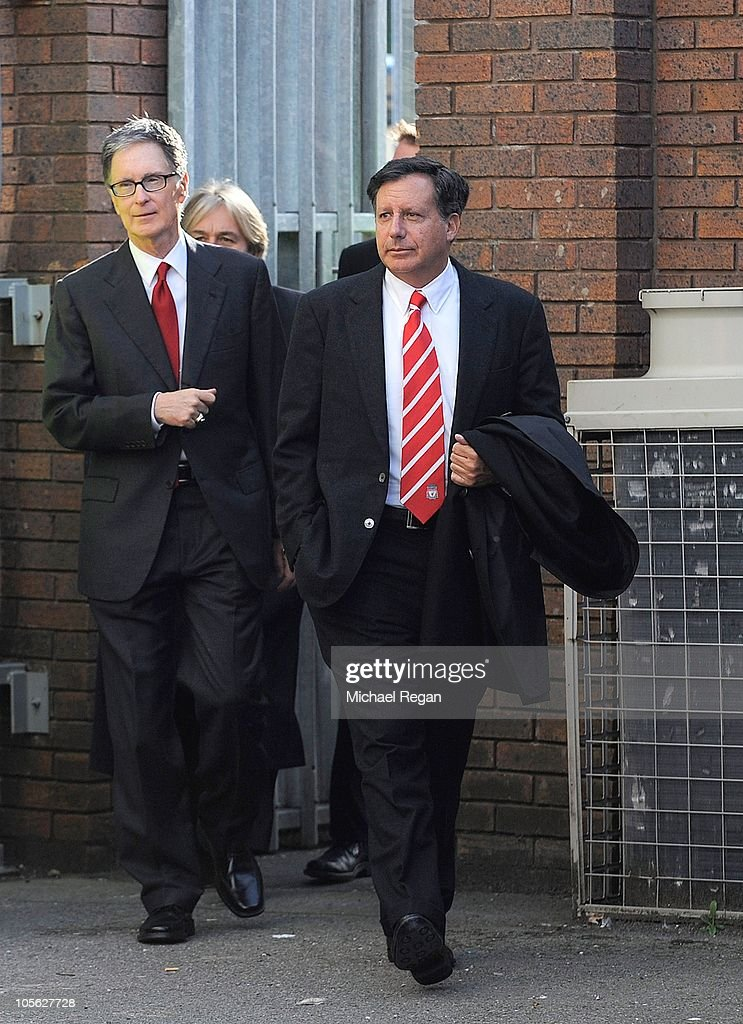 New Liverpool co-owners John W Henry (L) and NESV Chairman Tom Werner arrive before the Barclays Premier League match between Everton and Liverpool at Goodison Park on October 17, 2010 in Liverpool, England.
