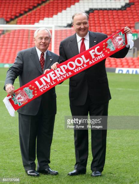 New Liverpool owners George Gillett and Tom Hicks hold a scarf during a press call at Anfield Liverpool