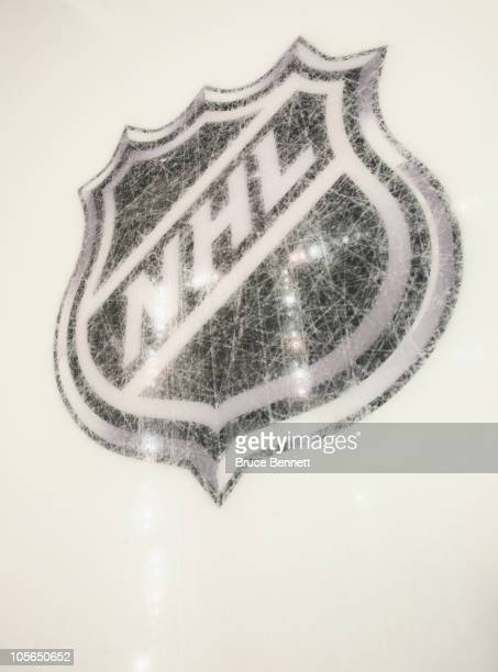 New logos are etched into the ice prior to the game between the Pittsburgh Penguins and the Philadelphia Flyers at the Consol Energy Center on...