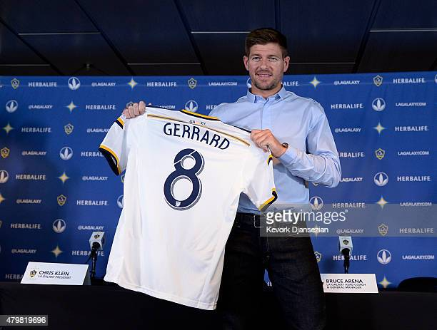New Los Angeles Galaxy midfielder Steven Gerrard poses with his jersey after a news conference on July 7 2015 at StubHub Center in Carson California...