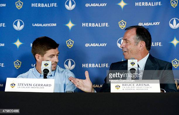 New Los Angeles Galaxy midfielder Steven Gerrard shakes hands with Bruce Arena LA Galaxy Head Coach and General Manager during a news conference on...