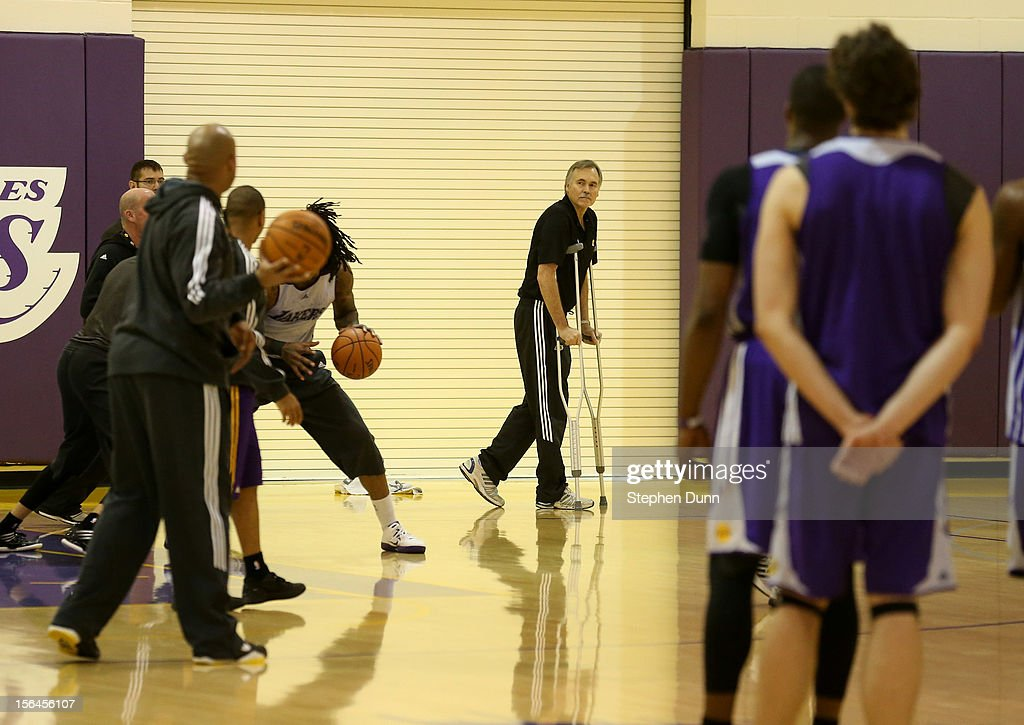 New Los Angeles Lakers head coach Mike D'Antoni (C) watches from his crutches as the Lakers practice berfore a press conference introducing him as the new Los Angeles Lakers head coach on November 15. 2012 at the Lakers practice facility at the Toyota Sports Center in El Segundo, California.