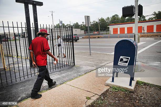 A new mail box replaces on one that had antipolice graffiti written across it during the violent protests which erupted in the city after the death...