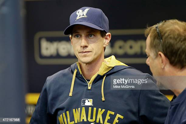 New manager Craig Counsel of the Milwaukee Brewers looks on from the dugout before the start of the game against the Los Angeles Dodgers at Miller...