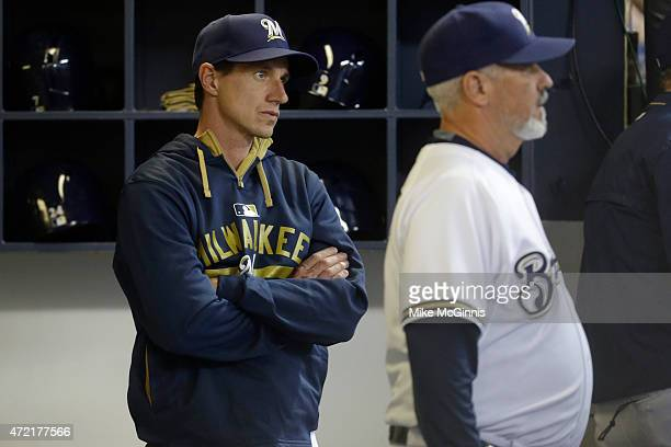 New manager Craig Counsel of the Milwaukee Brewers stands in the dugout during the fourth inning against the Los Angeles Dodgers at Miller Park on...