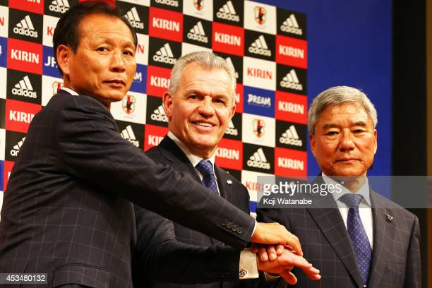 New Manager for Japan National Soccer Team Javier Aguirre shakes hands with Japan Football Association president Kuniya Daini and JFA executive...