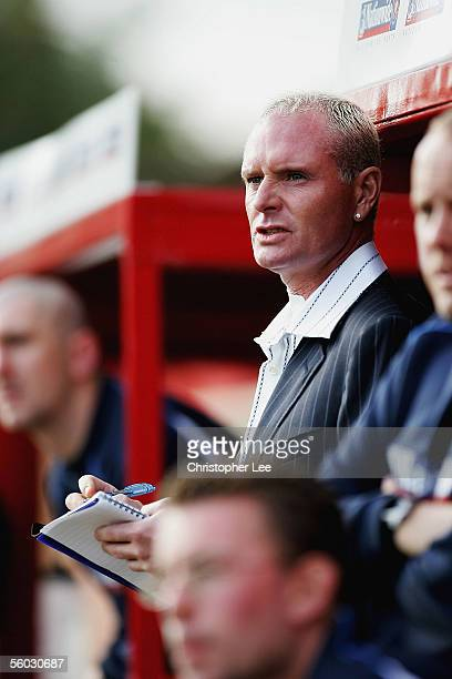 New manager Paul Gascoigne writes down notes during the Nationwide Conference North match between Kettering Town and Droylsden at Rockingham Road on...