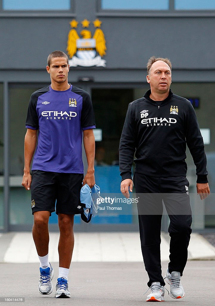 New Manchester City player Jack Rodwell (L) arrives ahead of the press conference with first team coach David Platt at the MCFC Carrington Training Complex on August 17, 2012 in Manchester, England.