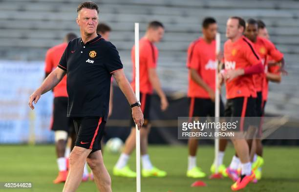 New Manchester United coach Louis Van Gaal walks across the pitch during a training session for his players at the Rose Bowl in Pasadena California...