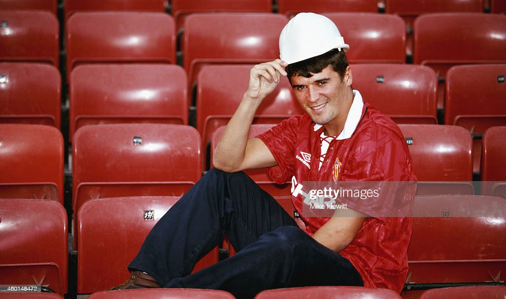 New Manchester United signing Roy Keane poses with a builders hard hat at Old Trafford after signing from Nottingham Forest ahead of the 1993/94...