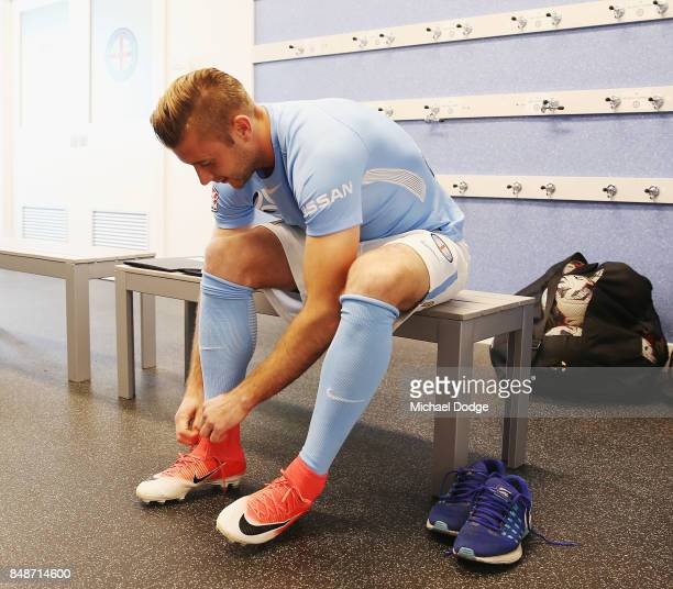 New marquet signing Marcin Budzinksi laces up during a Melbourne City ALeague press conference at the City Football Academy on September 18 2017 in...