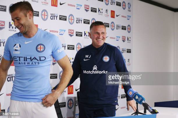 New marquet signing Marcin Budzinksi leaves with coach Warrem Joyce after speaking to media during a Melbourne City ALeague press conference at the...