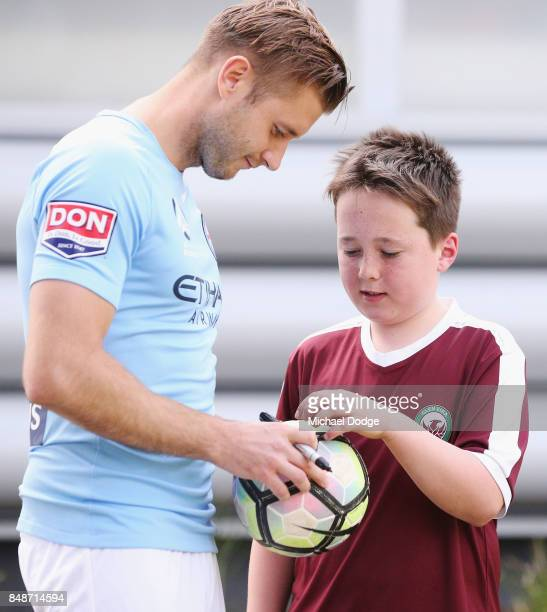 New marquet signing Marcin Budzinksi signs autographs for McDonalds Junior program kids during a Melbourne City ALeague press conference at the City...
