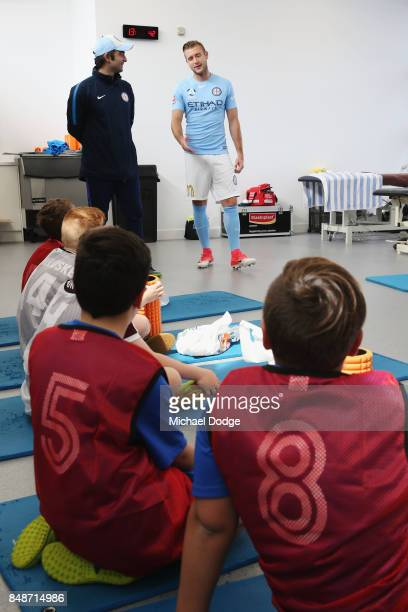 New marquet signing Marcin Budzinksi speaks to McDonalds Junior program kids during a Melbourne City ALeague press conference at the City Football...