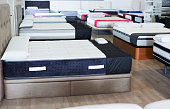 new style mattresses on the beds in the store.