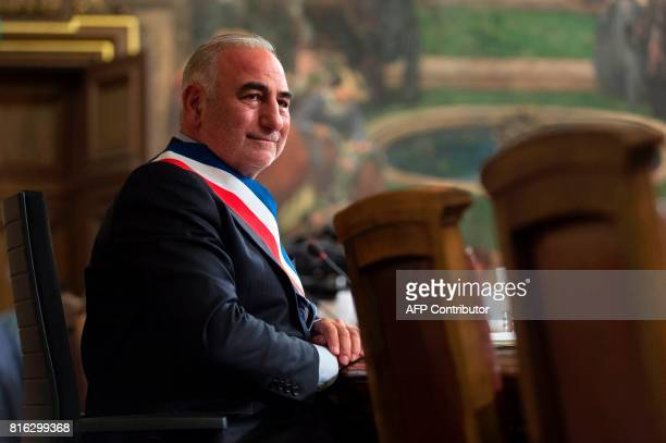 New Mayor of Lyon Georges Kepenekian looks on after being elected during a city council at the city hall in Lyon central eastern France on July 17...