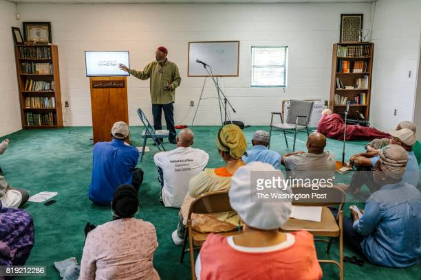 New Medinah MS May 26 2017 Retreat attendees listen to a presentation on reading Quranic Arabic by Aziz Uddin Bashir inside the masjid in New Medinah...