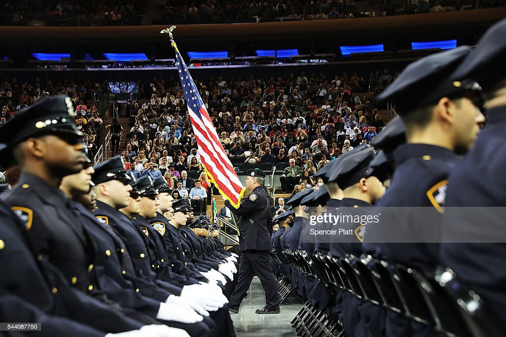 New members of New York City's police department's graduating class participate in a swearing in ceremony at Madison Square Garden on July 1, 2016 in New York City. The New York City Police Department's (NYPD) current uniformed strength is approximately 34,500.