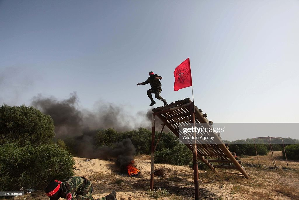 New members of the Palestinian National Resistance Brigades armed wing of the Democratic Front for the Liberation of Palestine participate in a...