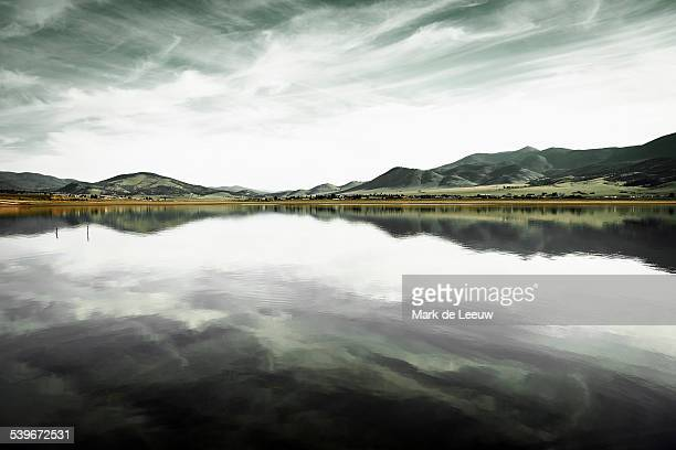 USA, New Mexico, Eagle Nest Lake State Park, Landscape with mountain range and calm lake