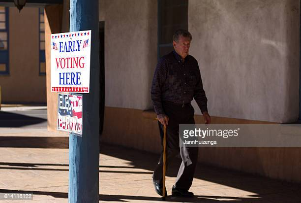 New Mexico: 'EARLY VOTING HERE' Sign, Voter with Cane